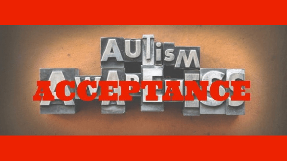 """The words Autism Awareness made from vintage lead letterpress type. Over the word """"awareness"""" is the word """"acceptance"""" in bold red letters."""