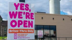"Sign that says ""Yes we're open, Drive Thru Only"""