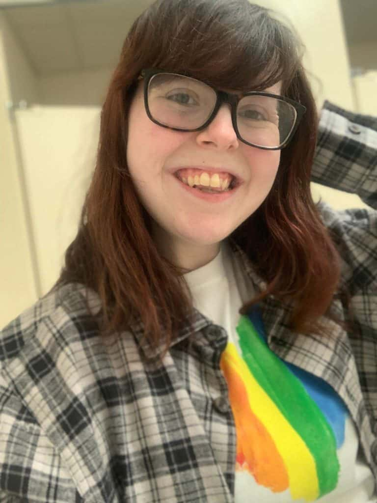 A selfie of Taylor in a pride t-shirt.