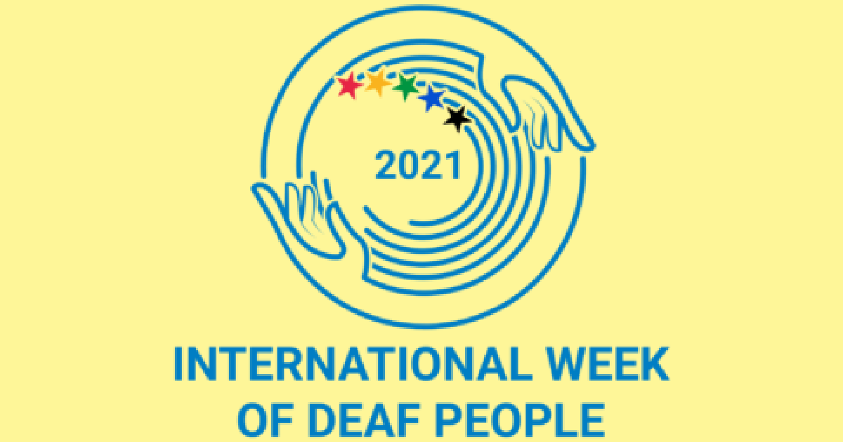 2021 International Week of Deaf People logo - a circle made of two hands surrounding a rainbow of stars